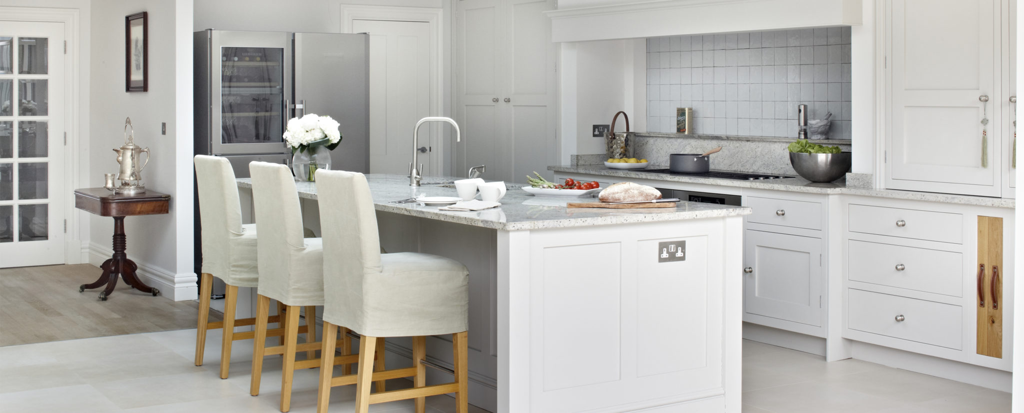 Large country kitchen design in Surrey - light grey kitchen cabinets and Kashmir white granite countertops