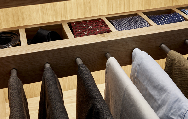 Bespoke wardrobe design with integrated tie drawer and trouser rack