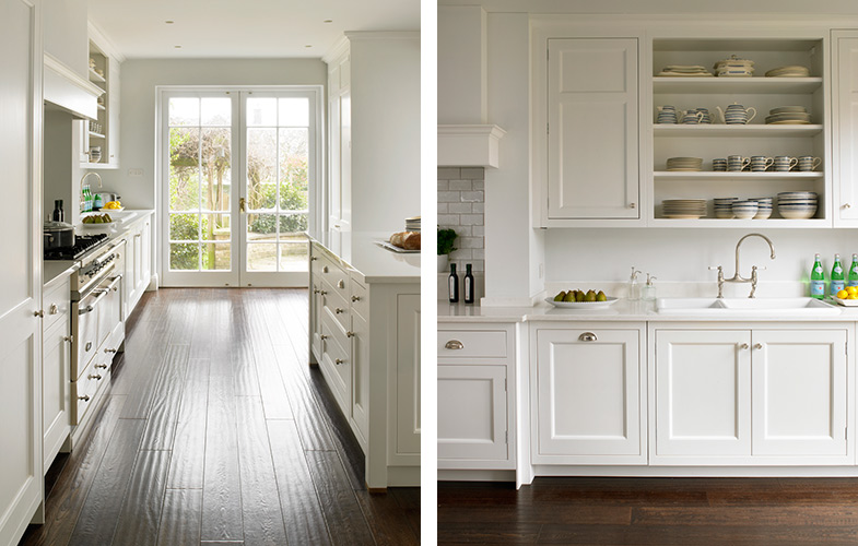 Wandsworth Kitchen leading out to garden with dark wood flooring and white cabinets.