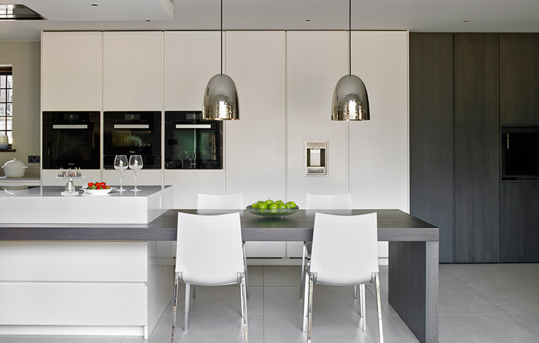 Wimbledon kitchen island and adjoined dining table