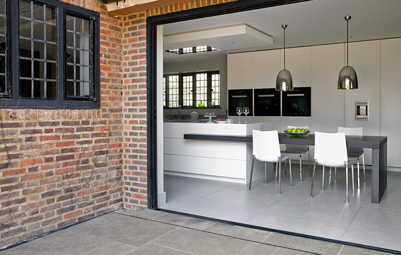 Open plan kitchen, dining room and outdoor design in Wimbledon
