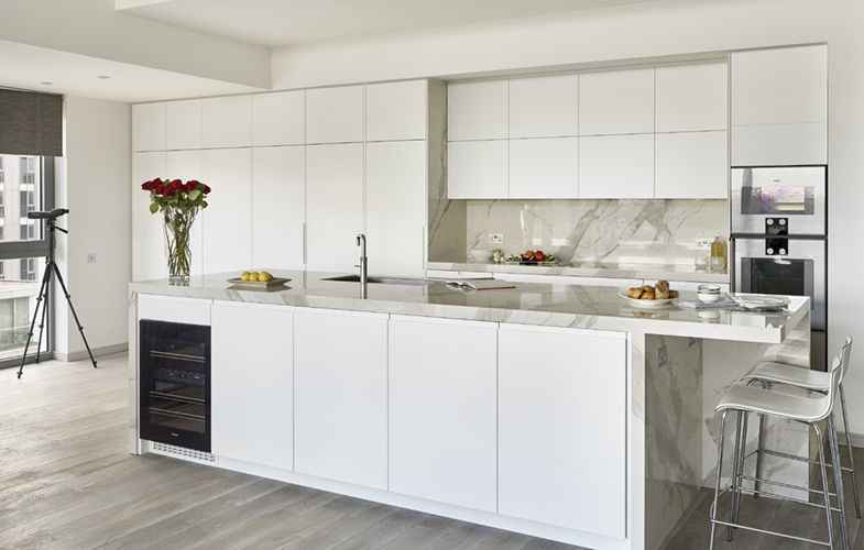 London penthouse kitchen - modern white design with island and breakfast bar seating
