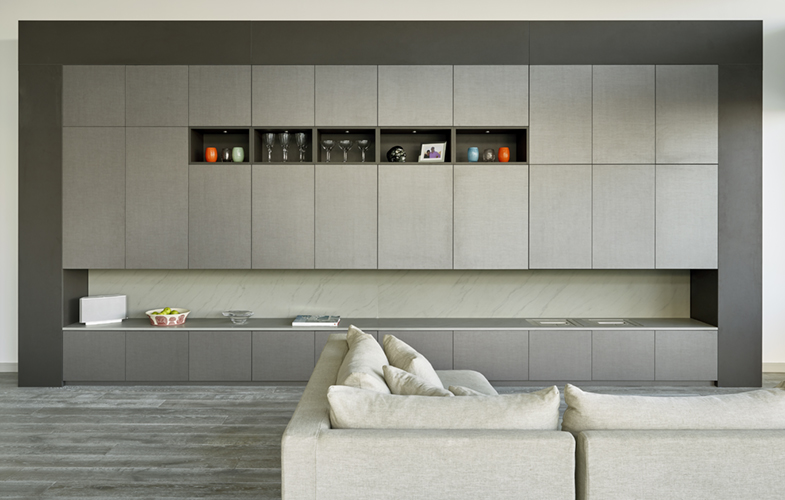 Large display cabinet/media wall design for Riverside Penthouse apartment in Wandsworth. Urban Grey and Grigio surfaces by Xylocleaf.