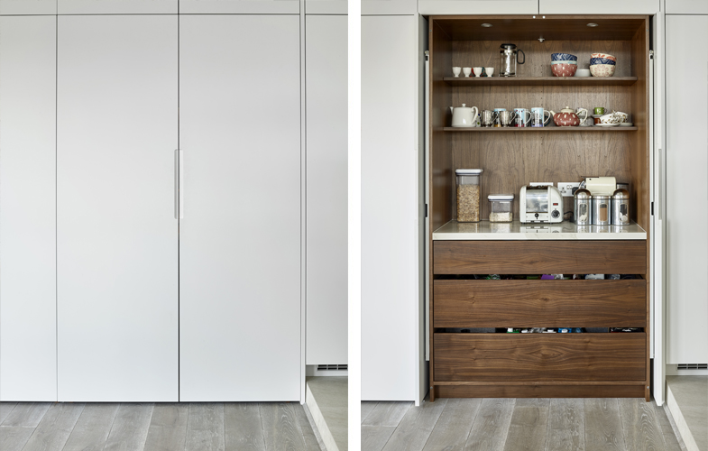 White breakfast cabinet and pantry cupboard with American blackl walnut interior