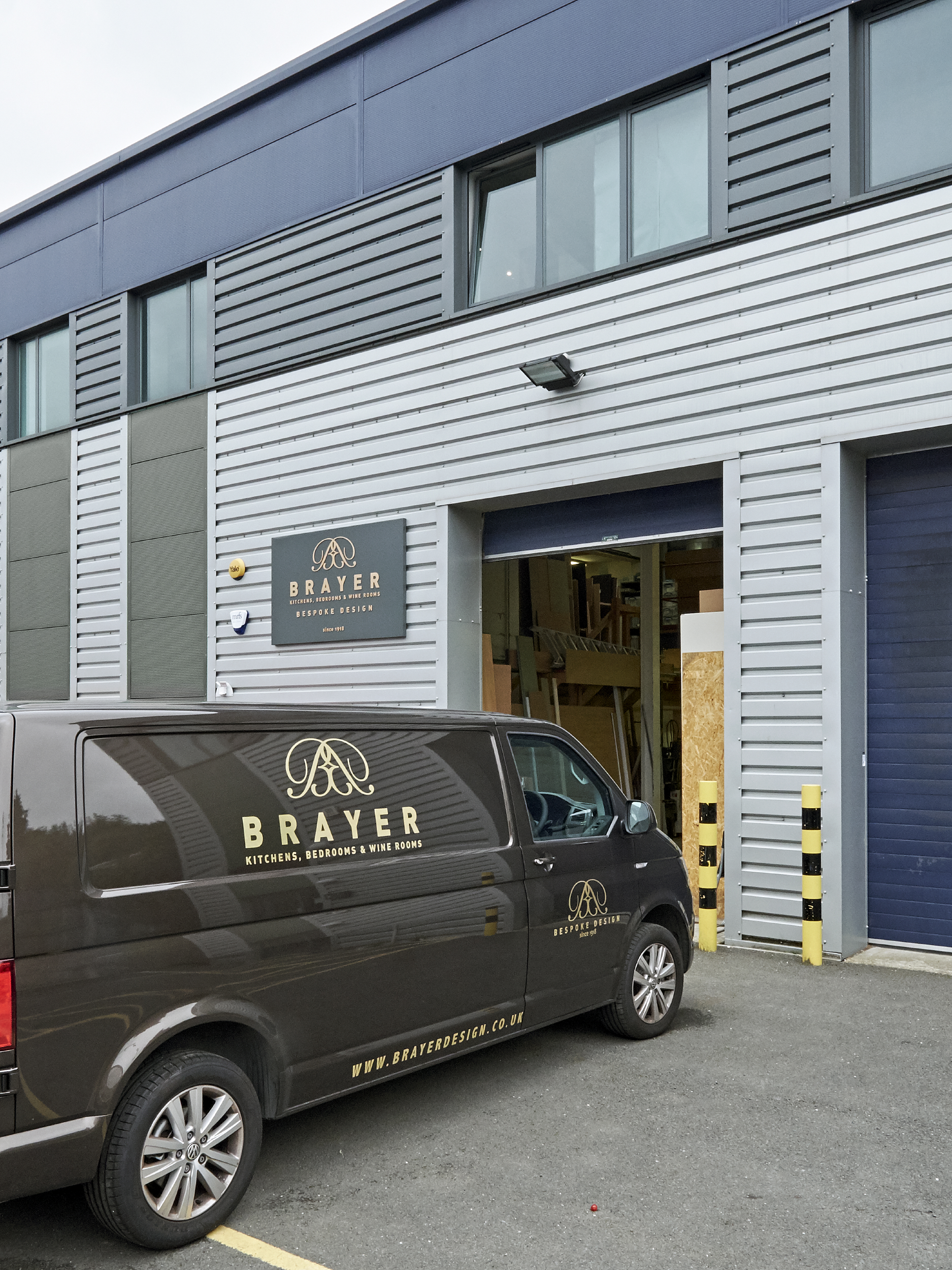 Brayer Design Workshop in Surbiton. Ground floor warehouse with van parked outside with design studio and showroom is on the first floor.