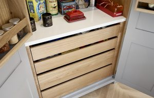 Light oak drawers and worktop inside grey country pantry cupboard
