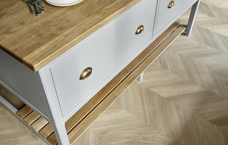 Surbiton kitchen island with deep drawers, burnished brass cup handles and oiled American white oak worktop