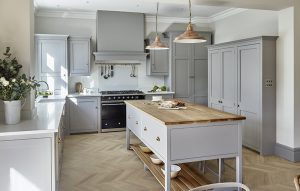 Country Kitchen Design in Light Grey Blue with Chevron Oak flooring and copper accents