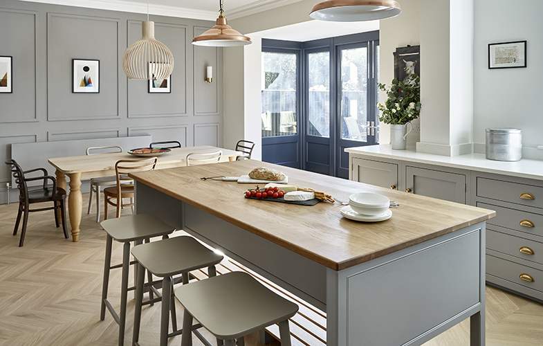 Open plan kitchen design with custom cabinets and wall panels hand painted in Little Greene 'Lead' french doors finished Farrow & Ball 'Railings'