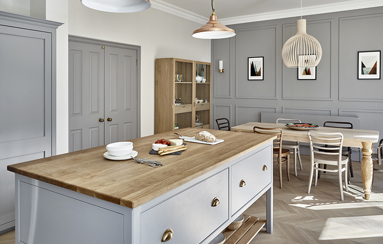Kitchen island and dining area of Surbiton bespoke grey fitted kitchen