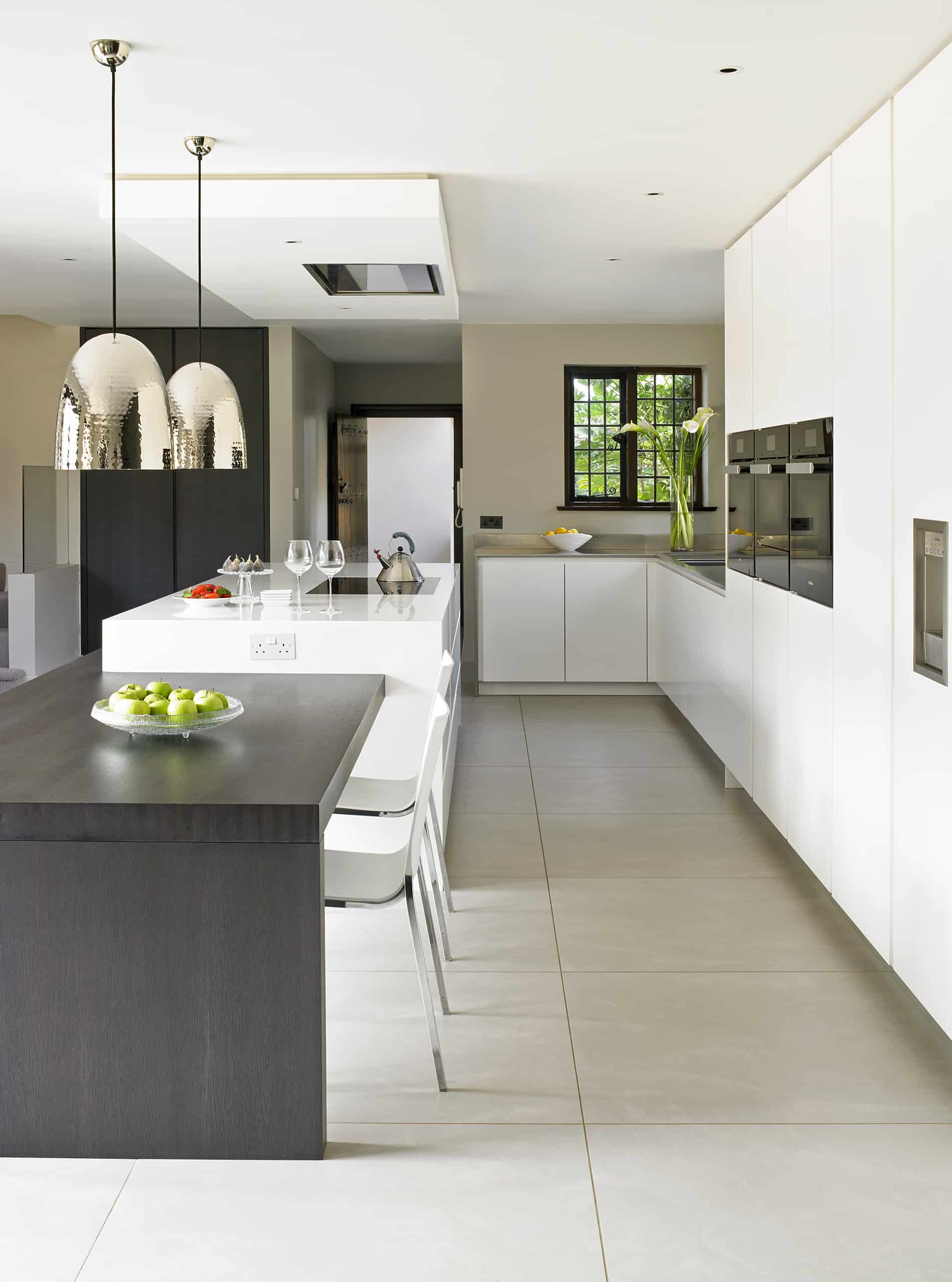Large Wimbledon Modern White Kitchen with adjoined island dining table
