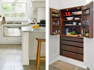 Traditional white country kitchen with island and pantry cupboard with Walnut Interior