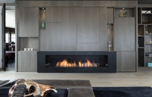 Chelsea apartment Media Wall concealing large screen TV over fireplace