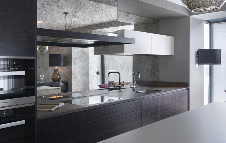 Chelsea kitchen with dark wood cabinets and mirror splashback